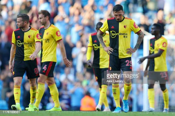 Jose Holebas of Watford and team mates look dejected after their 8-0 defeat in the Premier League match between Manchester City and Watford FC at...