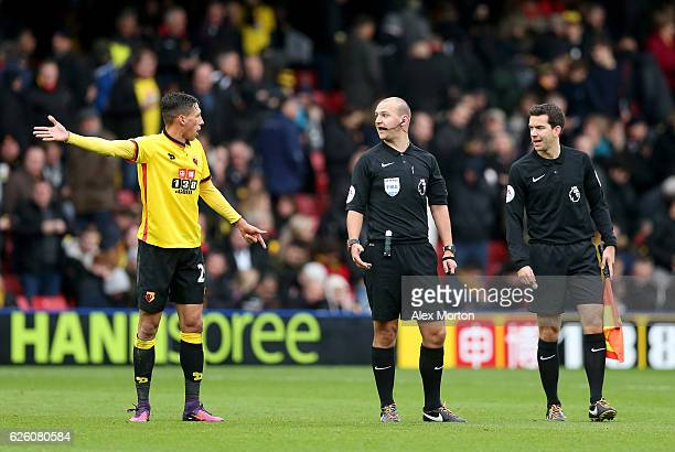 Jose Holebas of Watford argues with Referee Bobby Madley at half time during the Premier League match between Watford and Stoke City at Vicarage Road...