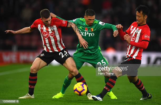 Jose Holebas of Watford battles for possession with PierreEmile Hojbjerg and Maya Yoshida of Southampton during the Premier League match between...