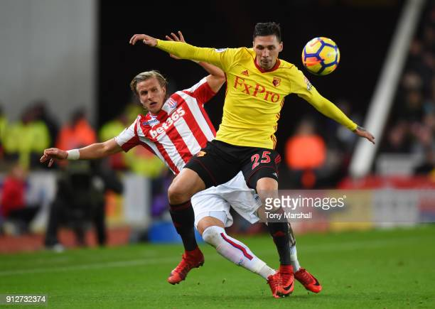 Jose Holebas of Watford bfp Phil Bardsley of Stoke City during the Premier League match between Stoke City and Watford at Bet365 Stadium on January...