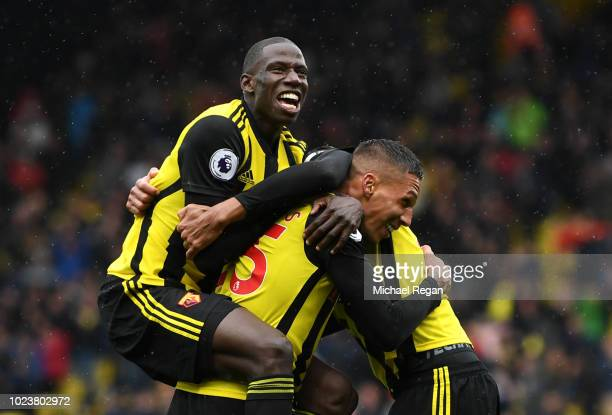 Jose Holebas of Watford celebrates with teammate Abdoulaye Doucoure of Watford after scoring his team's second goal during the Premier League match...
