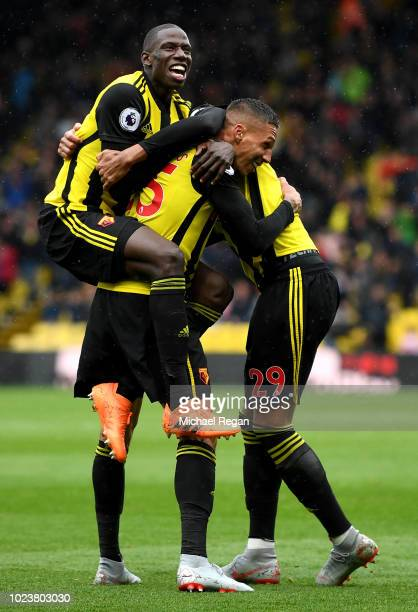 Jose Holebas of Watford celebrates with teammates Abdoulaye Doucoure and Etienne Capoue of Watford after scoring his team's second goal during the...