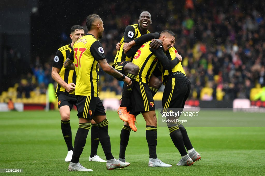 Jose Holebas of Watford celebrates with teammates after scoring his team's second goal during the Premier League match between Watford FC and Crystal Palace at Vicarage Road on August 26, 2018 in Watford, United Kingdom.