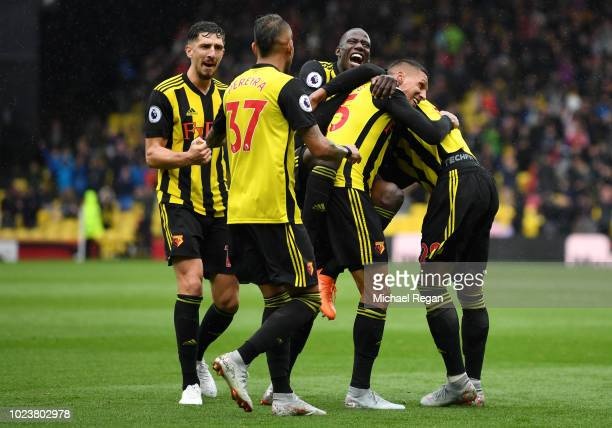 Jose Holebas of Watford celebrates with teammates after scoring his team's second goal during the Premier League match between Watford FC and Crystal...