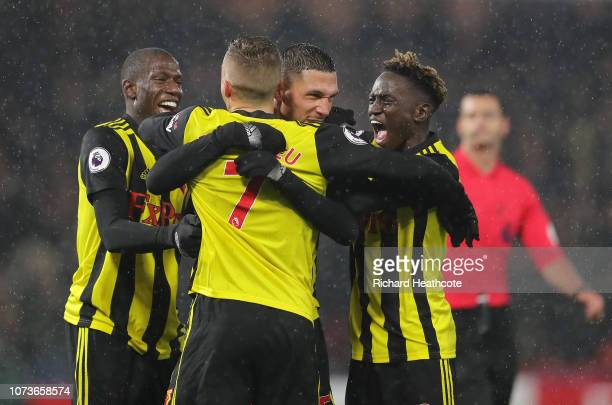 Jose Holebas of Watford celebrates with teammates after scoring his team's second goal during the Premier League match between Watford FC and Cardiff...