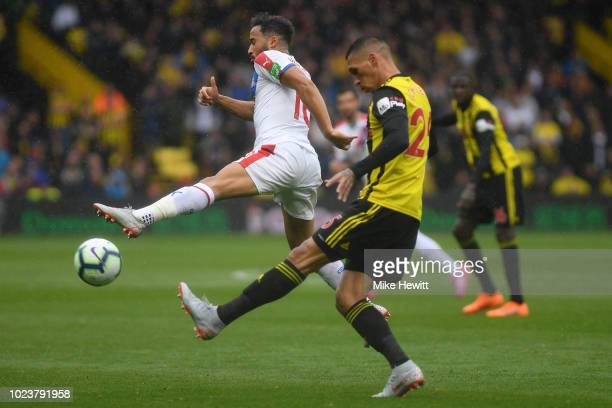 Jose Holebas of Watford challenges for the ball with Andros Townsend of Crystal Palace during the Premier League match between Watford FC and Crystal...