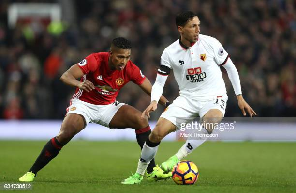 Jose Holebas of Watford controls the ball under pressure of Antonio Valencia of Manchester United during the Premier League match between Manchester...