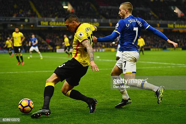 Jose Holebas of Watford evades Gerard Deulofeu of Everton during the Premier League match between Watford and Everton at Vicarage Road on December 10...
