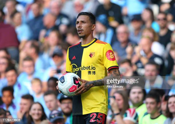 Jose Holebas of Watford FC takes a throw in during the Premier League match between Manchester City and Watford FC at Etihad Stadium on September 21...