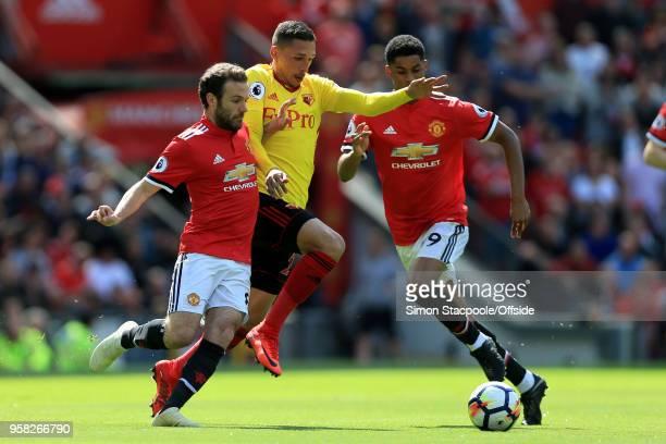 Jose Holebas of Watford gets between Juan Mata of Man Utd and Marcus Rashford of Man Utd during the Premier League match between Manchester United...