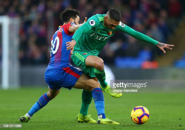 Jose Holebas of Watford is challenged by Andros Townsend of Crystal Palace during the Premier League match between Crystal Palace and Watford FC at...