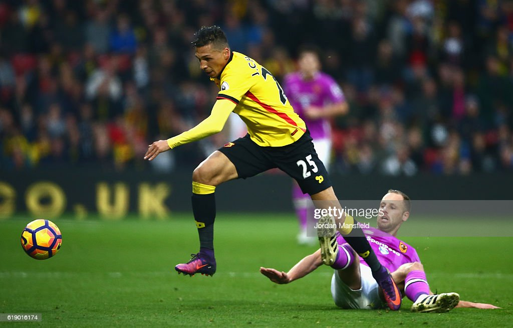 Jose Holebas of Watford (L) is tackled by David Meyler of Hull City (R) during the Premier League match between Watford and Hull City at Vicarage Road on October 29, 2016 in Watford, England.