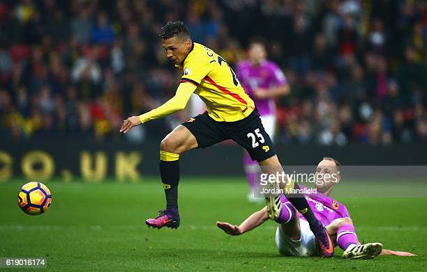 Jose Holebas of Watford is tackled by David Meyler of Hull City during the Premier League match between Watford and Hull City at Vicarage Road on...