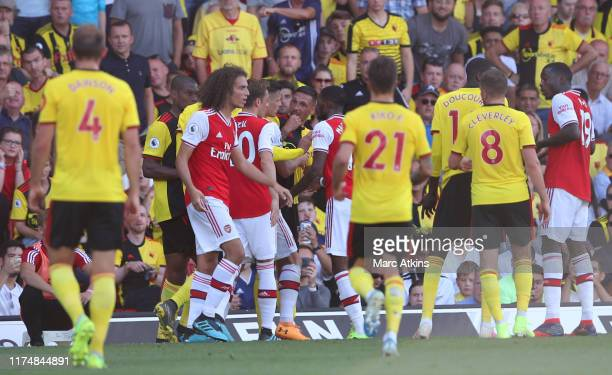 Jose Holebas of Watford looks towards Matteo Guendouzi of Arsenal as players clash during the Premier League match between Watford FC and Arsenal FC...
