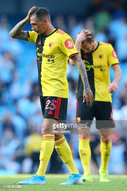 Jose Holebas of Watford reacts to losing 8-0 after the Premier League match between Manchester City and Watford FC at Etihad Stadium on September 21,...