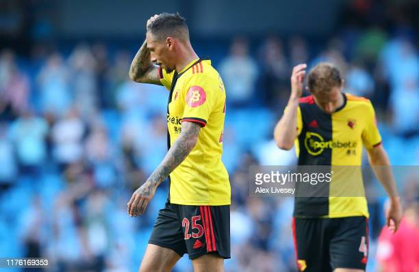 Jose Holebas of Watford reacts to losing 80 after the Premier League match between Manchester City and Watford FC at Etihad Stadium on September 21...