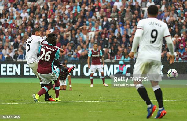 Jose Holebas of Watford scores his sides first goal during the Premier League match between West Ham United and Watford at Olympic Stadium on...