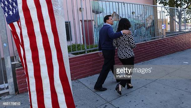 Jose Huizar and his wife Richelle walk out after casting their votes at Sheridan Street School on March 3 2015 in Los Angeles California Polls opened...