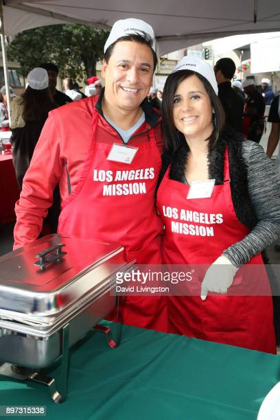 Jose Huizar and Richelle Huizar are seen at the Los Angeles Mission's Christmas Celebration on Skid Row on December 22 2017 in Los Angeles California