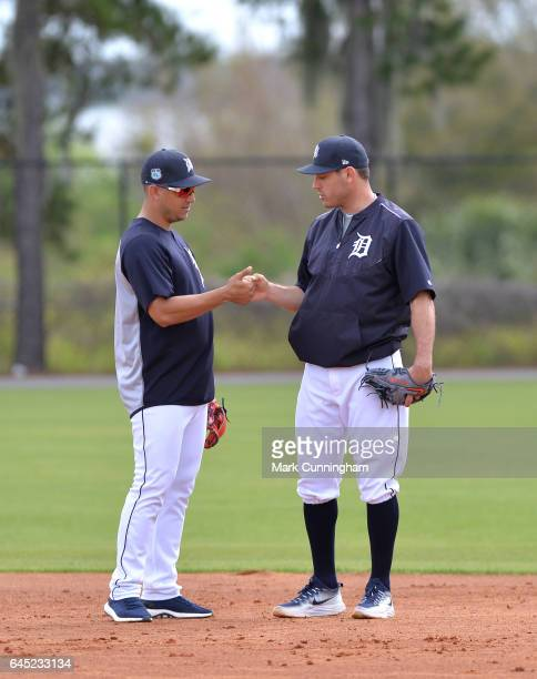 Jose Iglesias and Ian Kinsler of the Detroit Tigers shake hands during Spring Training workouts at the TigerTown facility on February 21 2017 in...