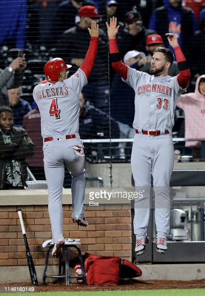 Jose Iglesias and Jesse Winker of the Cincinnati Reds celebrate their runs in the ninth inning against the New York Mets at Citi Field on April 30,...