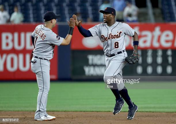 Jose Iglesias and Justin Upton of the Detroit Tigers celebrate the 20 win over the New York Yankees on August 2 2017 at Yankee Stadium in the Bronx...