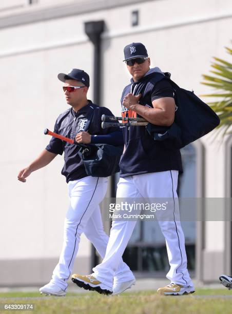 Jose Iglesias and Victor Martinez of the Detroit Tigers walk to the practice fields during Spring Training workouts at the TigerTown complex on...