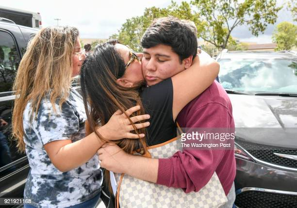 Jose Iglesias gets a kiss from his mother Carmen and a hug from his sister Francesca as he boarded a bus for Tallahassee to protest to the Florida...
