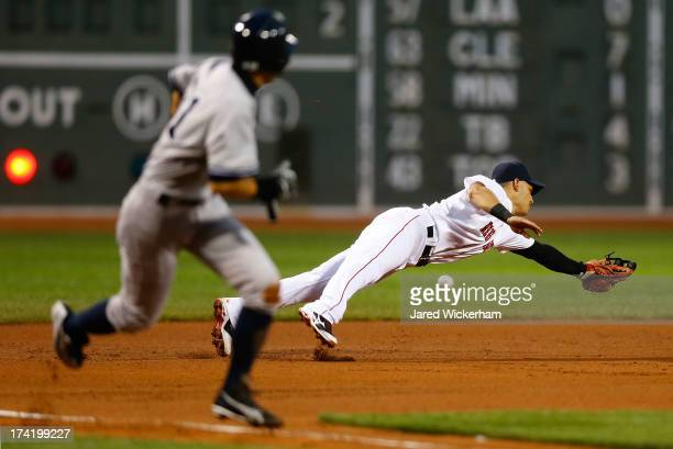 Jose Iglesias of the Boston Red Sox dives in front of Ichiro Suzuki of the New York Yankees but cannot come up with a line drive RBI in the first...