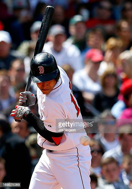 Jose Iglesias of the Boston Red Sox is hit by a pitch against the Cleveland Indians in the 3rd inning at Fenway Park on May 26 2013 in Boston...