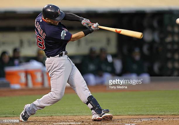 Jose Iglesias of the Boston Red Sox makes contact with a pitch during a game against the Oakland Athletics at Oco Coliseum on August 31 2012 in...