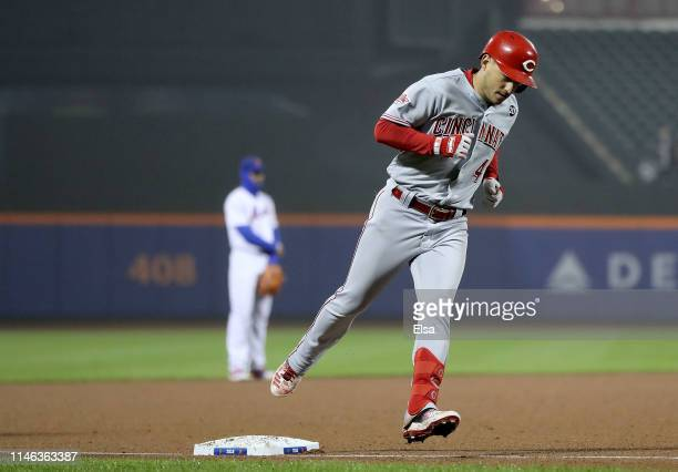 Jose Iglesias of the Cincinnati Reds rounds third after he hit a solo home run in the ninth inning against the New York Mets at Citi Field on May 01...