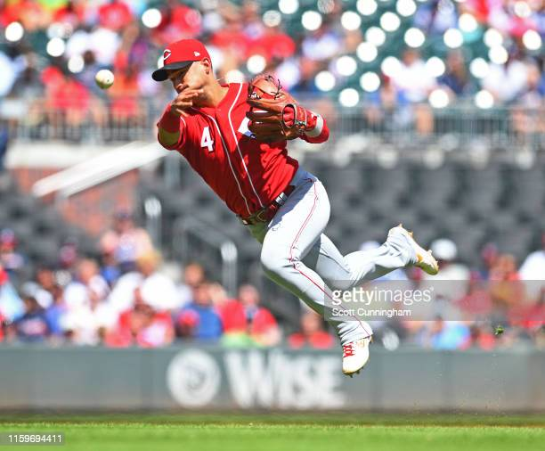 Jose Iglesias of the Cincinnati Reds throws out a runner during the sixth inning against the Atlanta Braves at SunTrust Park on August 4 2019 in...