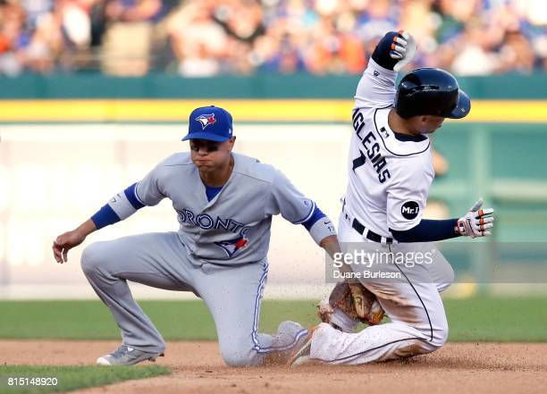 Jose Iglesias of the Detroit Tigers beats the tag from second baseman Ryan Goins of the Toronto Blue Jays to steal second base during the sixth...