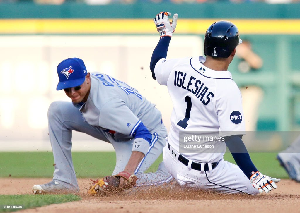 Jose Iglesias #1 of the Detroit Tigers beats the tag from second baseman Ryan Goins #17 of the Toronto Blue Jays to steal second base during the sixth inning at Comerica Park on July 15, 2017 in Detroit, Michigan.