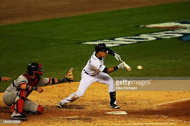 Jose Iglesias of the Detroit Tigers bunts in the fourth inning against the Boston Red Sox during Game Four of the American League Championship Series...
