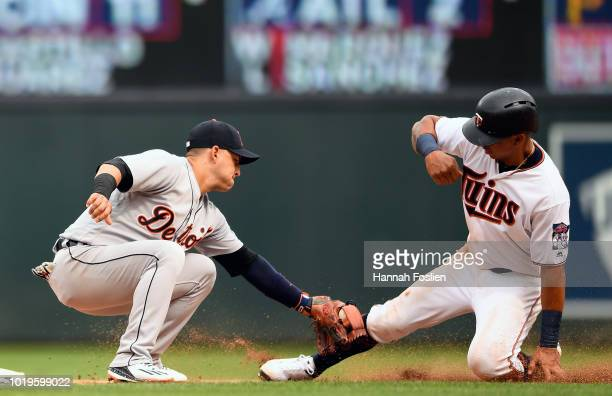 Jose Iglesias of the Detroit Tigers catches Ehire Adrianza of the Minnesota Twins stealing second base during the seventh inning of the game on...