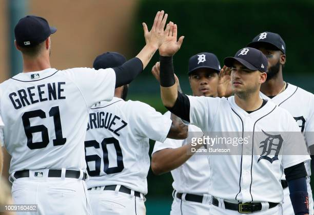 Jose Iglesias of the Detroit Tigers celebrates with closing pitcher Shane Greene after a 74 win over the Cincinnati Reds at Comerica Park on August 1...