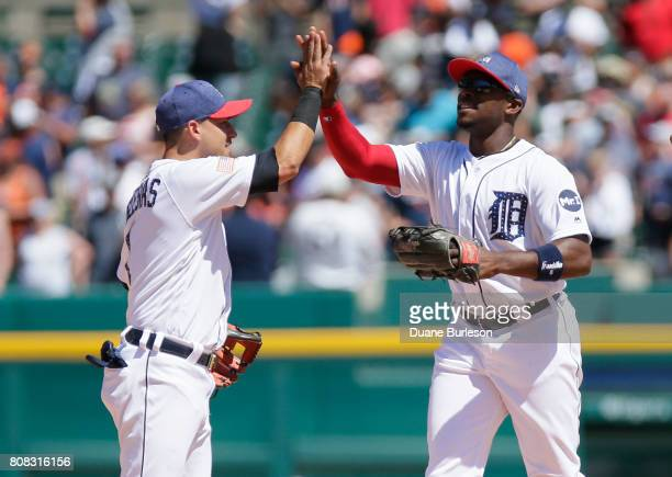 Jose Iglesias of the Detroit Tigers celebrates with Justin Upton of the Detroit Tigers after a 53 win over the San Francisco Giants at Comerica Park...