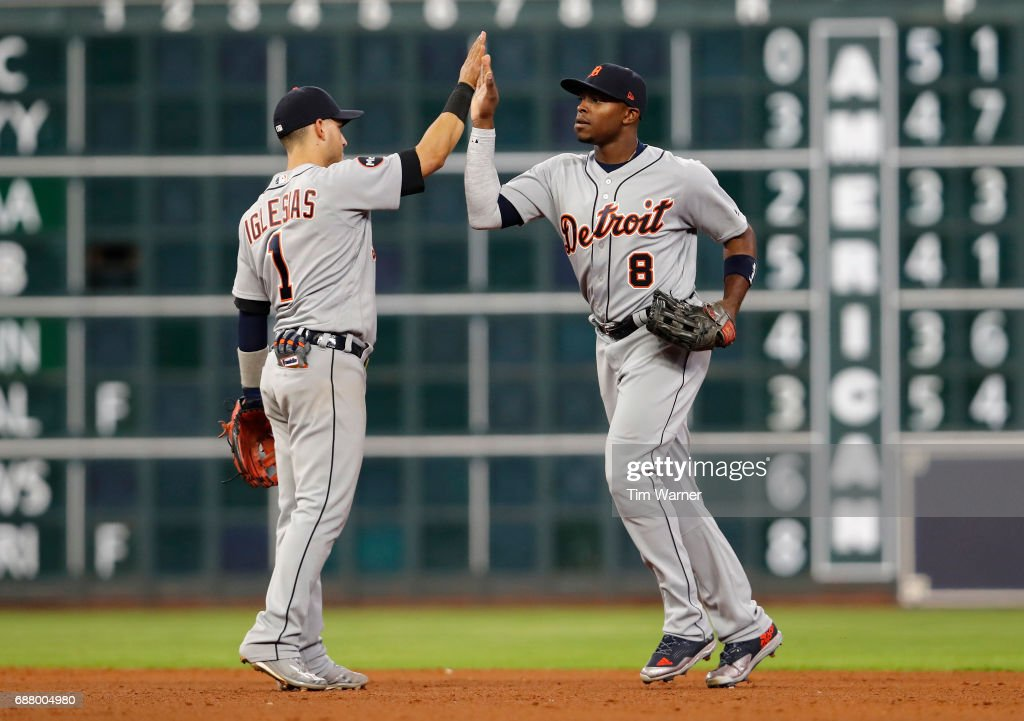 Jose Iglesias #1 of the Detroit Tigers celebrates with Justin Upton #8 after defeating the Houston Astros at Minute Maid Park on May 24, 2017 in Houston, Texas.