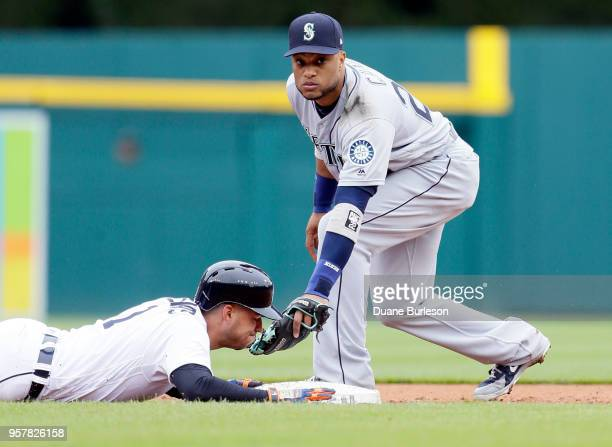 Jose Iglesias of the Detroit Tigers gets back safe to second base beating the tag from second baseman Robinson Cano of the Seattle Mariners during...