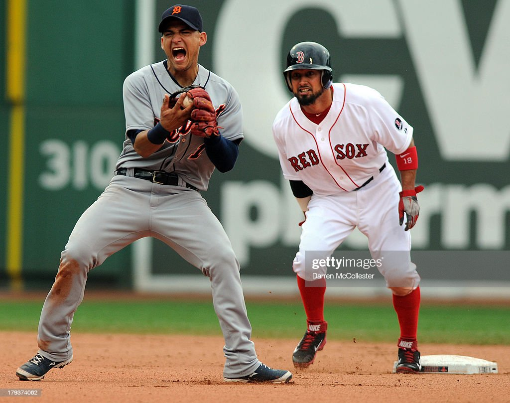 Jose Iglesias #1 of the Detroit Tigers grimaces after making the tag on Shane Victorino #18 of the Boston Red Sox in the sixth inning at Fenway Park on September 2, 2013 in Boston, Massachusetts.