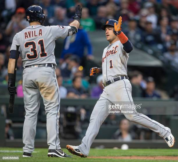 Jose Iglesias of the Detroit Tigers is greeted by Alex Avila of the Detroit Tigers after scoring a run on a double by Ian Kinsler of the Detroit...