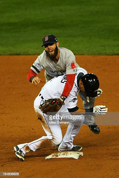 Jose Iglesias of the Detroit Tigers is out at second on a double play by turned by Dustin Pedroia of the Boston Red Sox in the sixth inning during...
