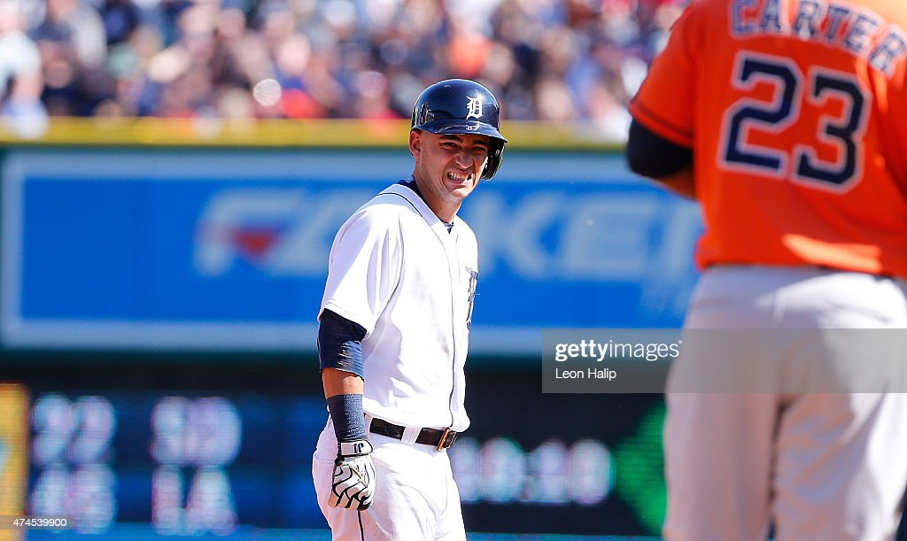 Jose Iglesias #1 of the Detroit Tigers looks to the Tigers dugout after stretching to reach first base during the third inning of the game against the Houston Astros on May 23, 2015 at Comerica Park in Detroit, Michigan.