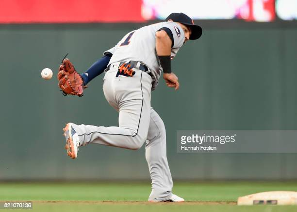 Jose Iglesias of the Detroit Tigers makes a play at shortstop to get out Max Kepler of the Minnesota Twins at second base during the fourth inning of...