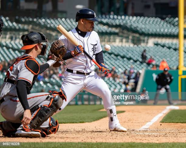 Jose Iglesias of the Detroit Tigers takes an inside pitch for a ball against the Baltimore Orioles during a MLB game at Comerica Park on April 18...