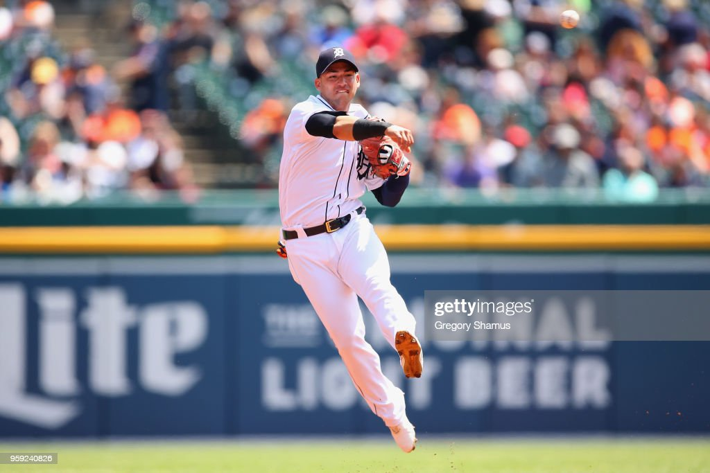 Jose Iglesias #1 of the Detroit Tigers throws to first base in the first inning while playing the Cleveland Indians at Comerica Park on May 16, 2018 in Detroit, Michigan.
