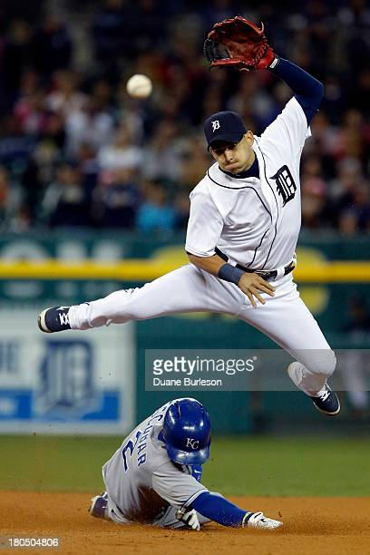 Jose Iglesias of the Detroit Tigers turns the ball after getting a force out on Alcides Escobar of the Kansas City Royals at second base in the ninth...