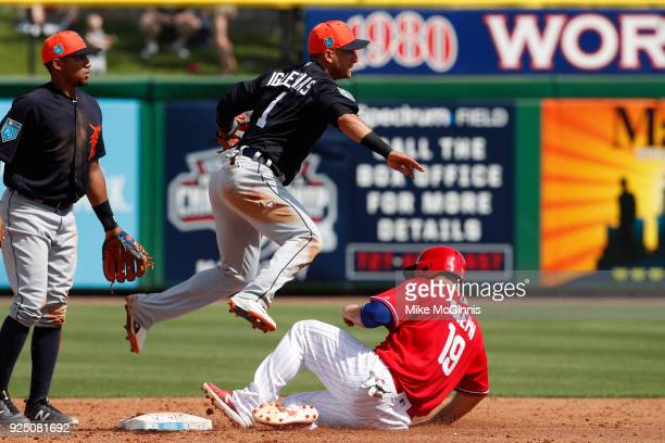 Jose Iglesias of the Detroit Tigers turns the double play as Tommy Joseph slides into second base during the second inning of the Spring Training...